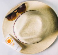 sunscreen and hat